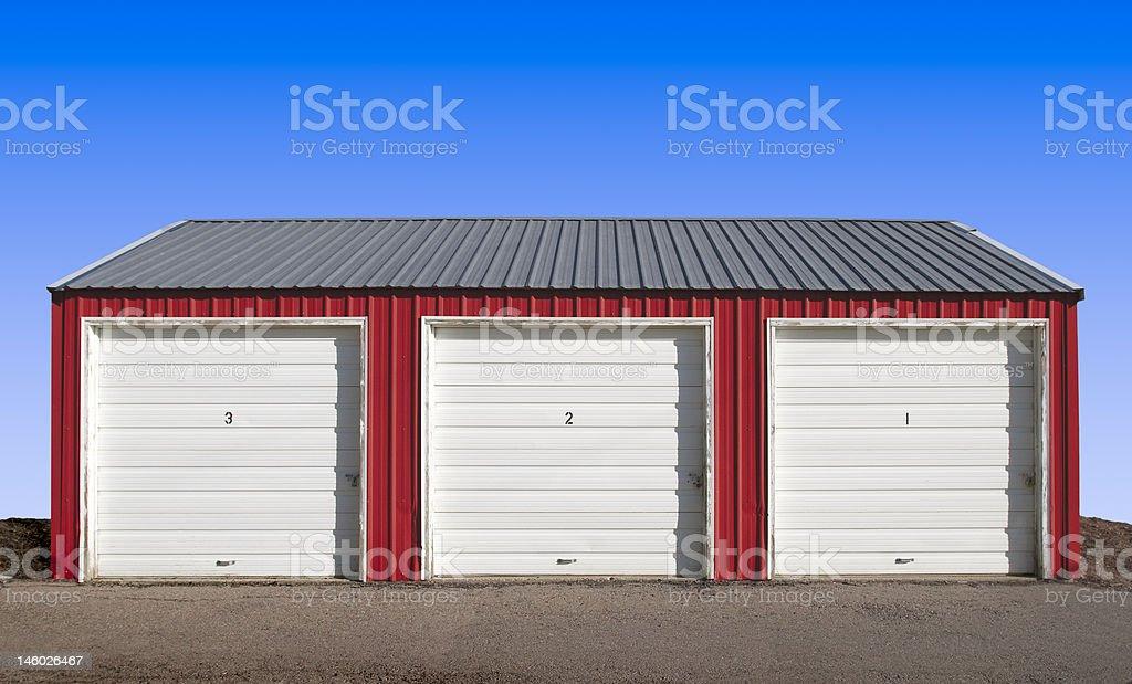 Three Storage Locker Doors with a Blue Sky Background stock photo