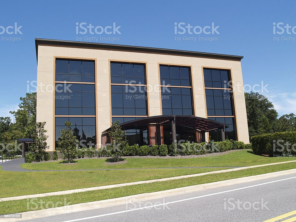 Three Story Office Building With Glass Front royalty-free stock photo