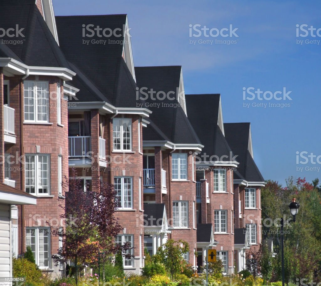 Three story urban homes in a row royalty-free stock photo