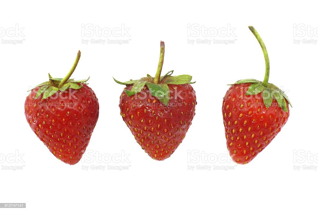 Three strawberries stock photo