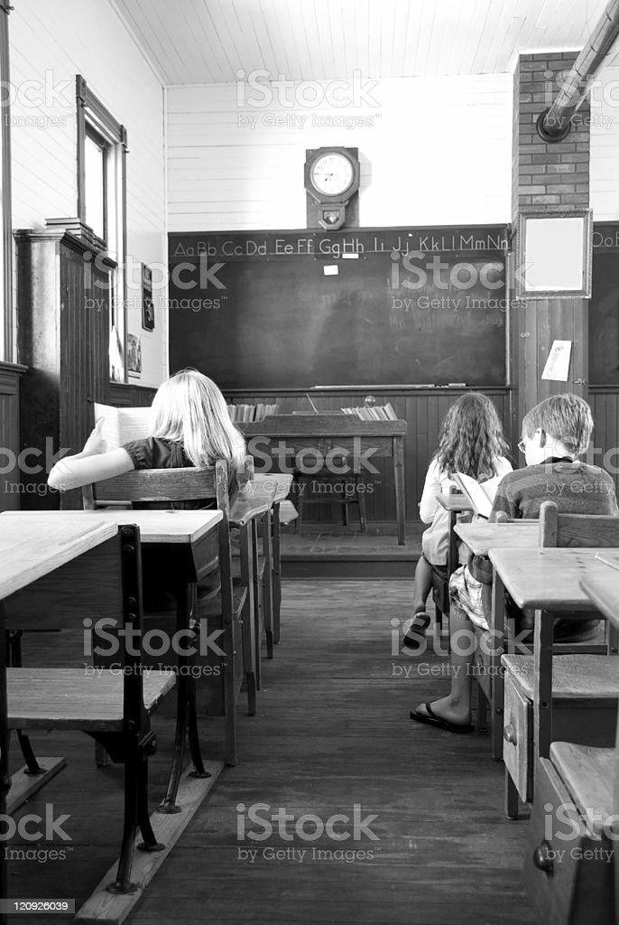 Three Students in Retro- aged School stock photo