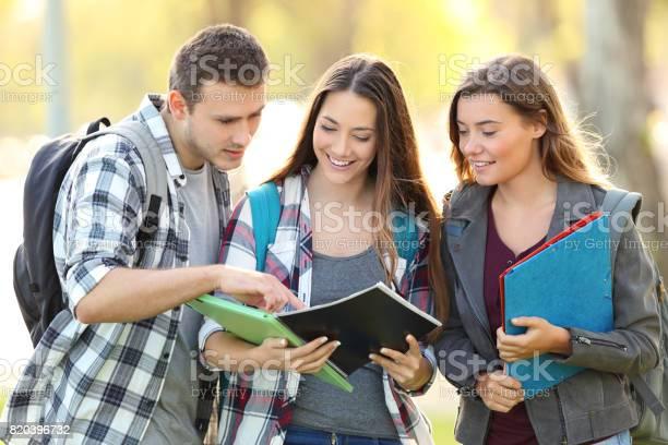 Three students learning reading notebook picture id820396732?b=1&k=6&m=820396732&s=612x612&h=jc3tynhzwhytd6rlfat fjhwseqat4 jrtszhmjumro=
