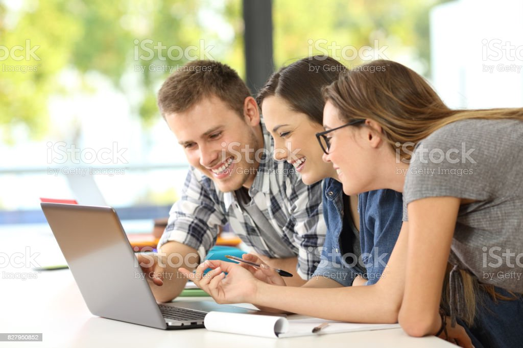 Three students learning together on line stock photo