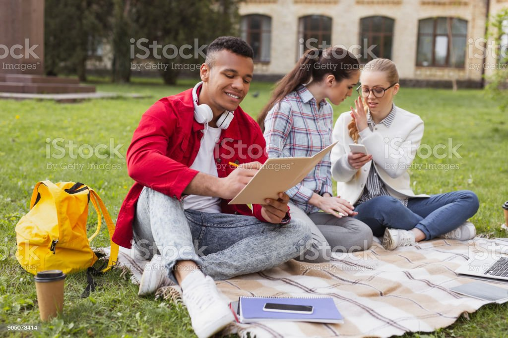 Three students preparing for important contest royalty-free stock photo