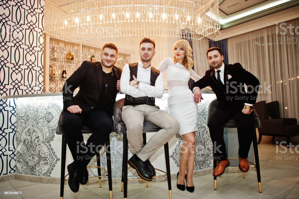 Three Stylish Bearded Man Well Dressed With One Blonde Girl In White Dress Posed Musician