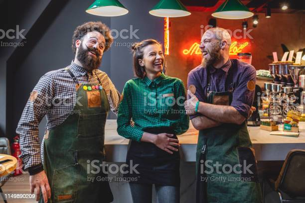 Three successful friends smiling and joking around at their work picture id1149890209?b=1&k=6&m=1149890209&s=612x612&h=regyx7daigrzmbyrjkzhfze mbvltyephqov g9nc80=
