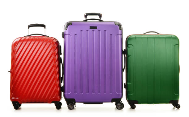 Three suitcases isolated on white Three suitcases isolated on white background carry on luggage stock pictures, royalty-free photos & images