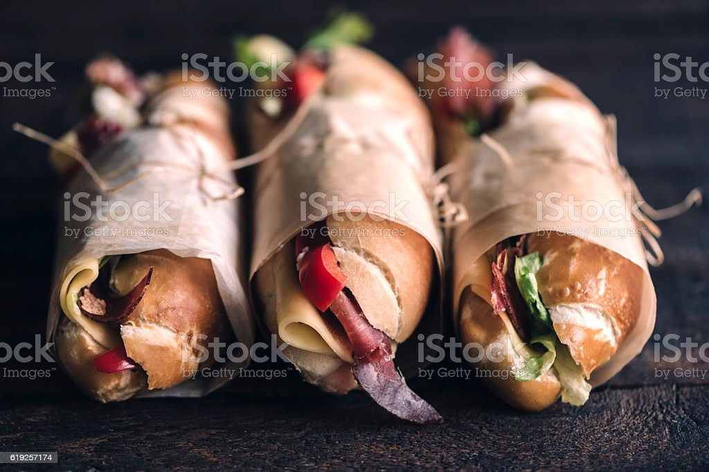 Three sumbmarine sandwiches stock photo