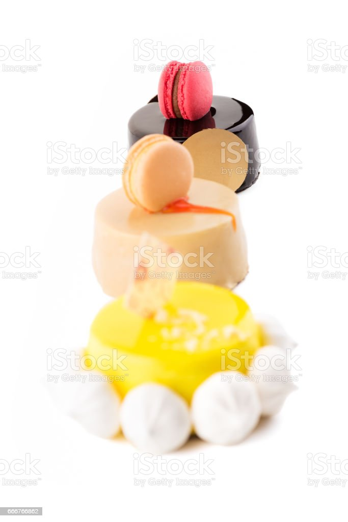 Three sweet and tasty cakes on the white background. foto stock royalty-free