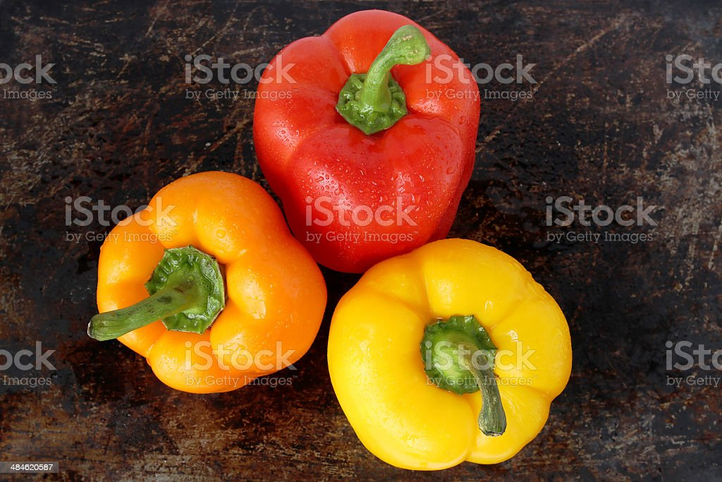 Three sweet peppers stock photo