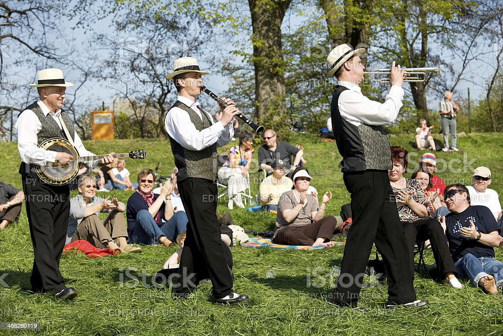 three swing jazz musicians playing at open air festival royalty-free stock photo