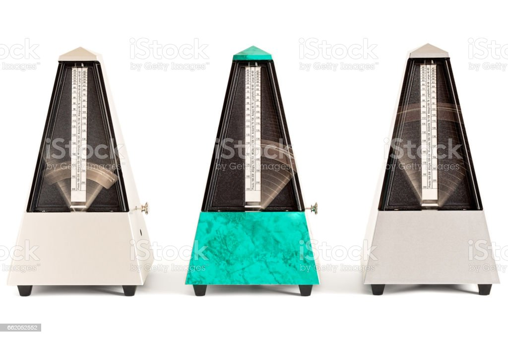 Three Swinging Pyramid Metronomes royalty-free stock photo