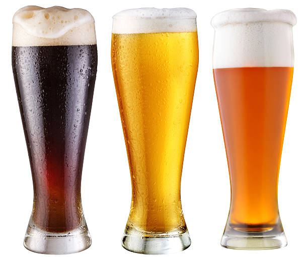 three tall glasses of different beers isolated on white - dark beer stock photos and pictures