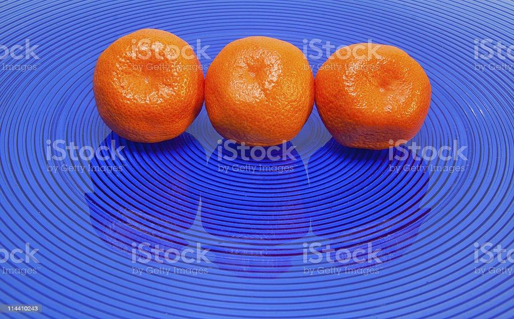 three tangerines stock photo