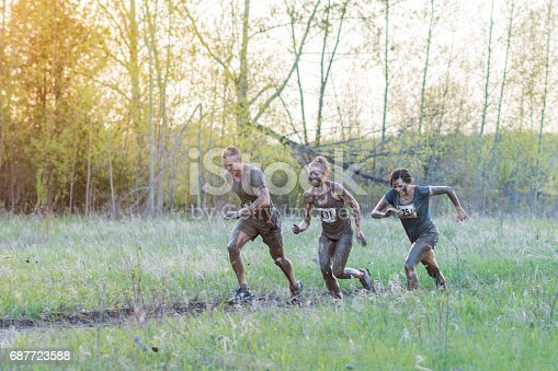 687723318istockphoto Three Teammates During Mud Run 687723588