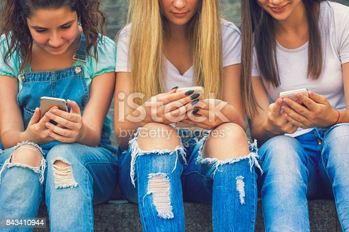 istock Three Teenage Girls Using Their Smartphones 843410944