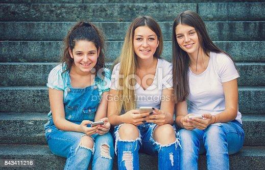 istock Three Teenage Girls Using Their Smartphones 843411216