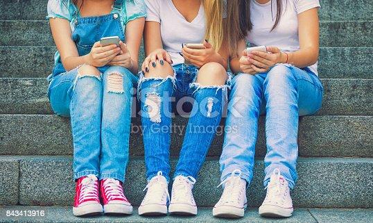 istock Three Teenage Girls Using Their Smartphones 843413916
