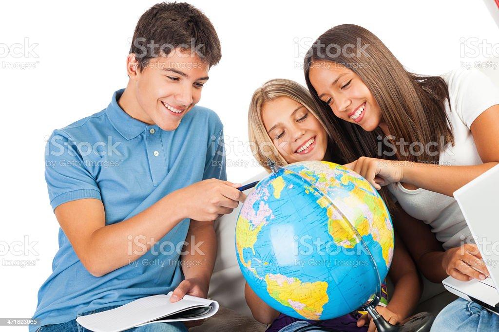 Three teenage students with  world globe royalty-free stock photo