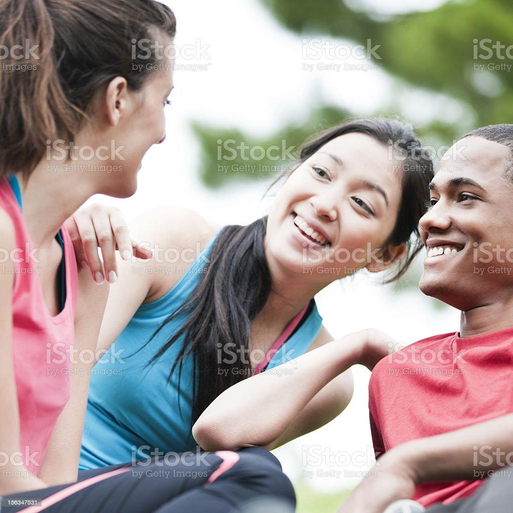Three teenagers enjoying their friendship in the park. royalty-free stock photo