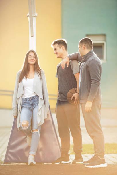 Three teenagers having fun stock photo