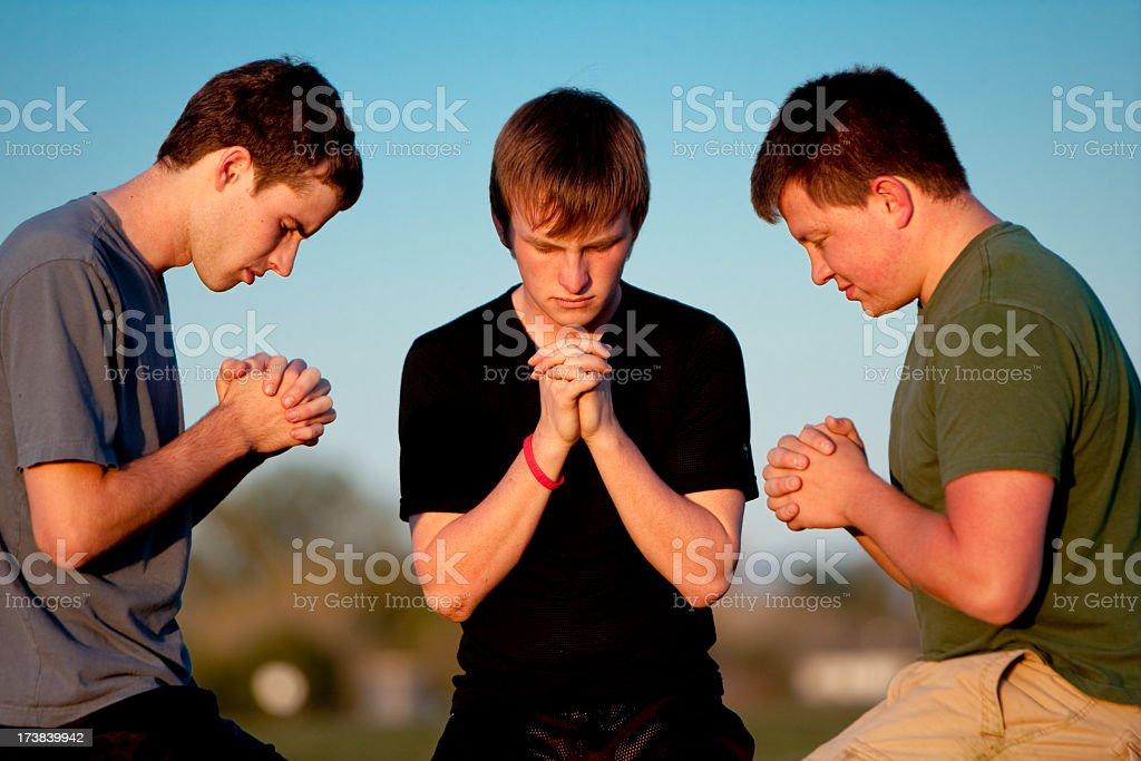 Three Teens Praying royalty-free stock photo