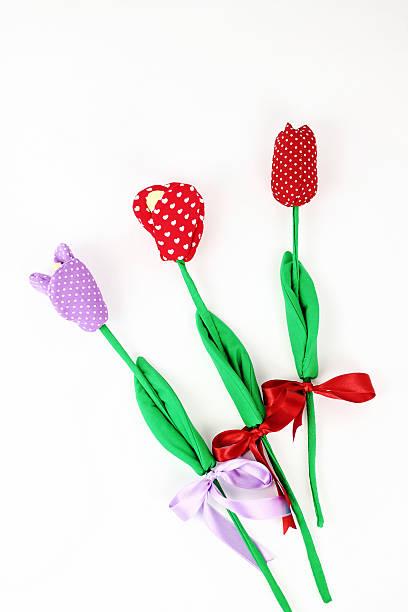 Three textile flowers on white background stock photo