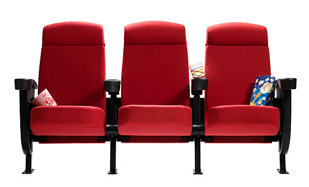 Three Theater Seats with popcorn bags, Isolated Three red movie theater seats with popcorn bags and barrel isolated on white background. burwellphotography stock pictures, royalty-free photos & images