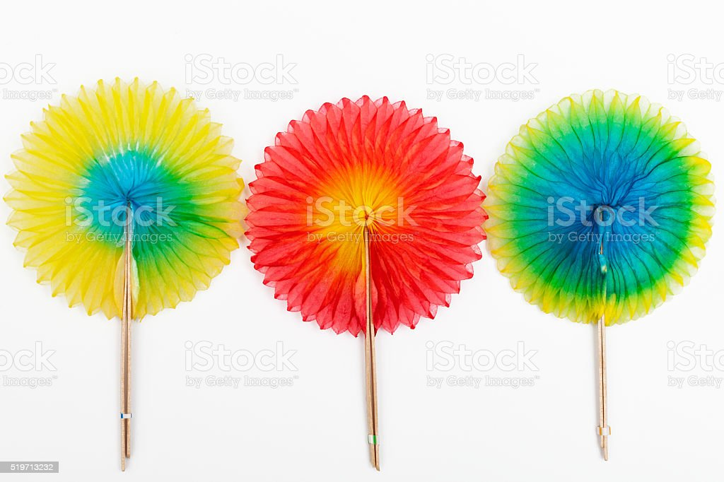 Three tissue paper cocktail fans stock photo
