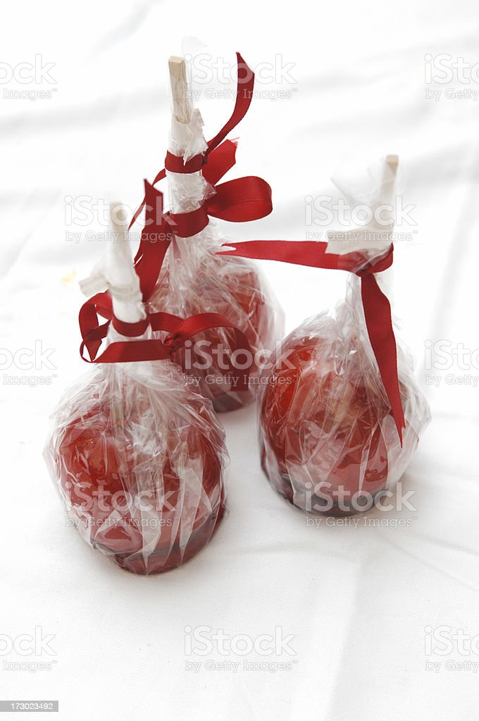 Three toffee apples royalty-free stock photo