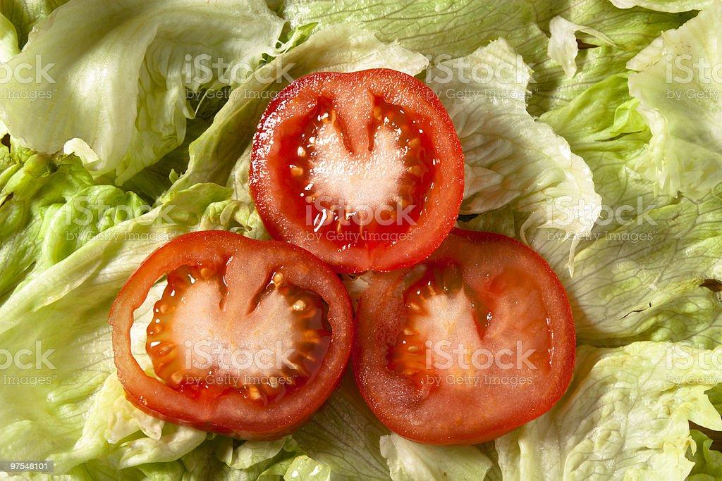Three Tomato Slices on Salad royalty-free stock photo