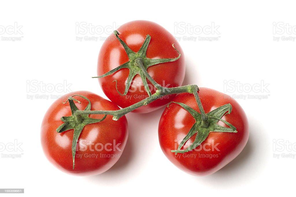 Three Tomatoes on Vine stock photo