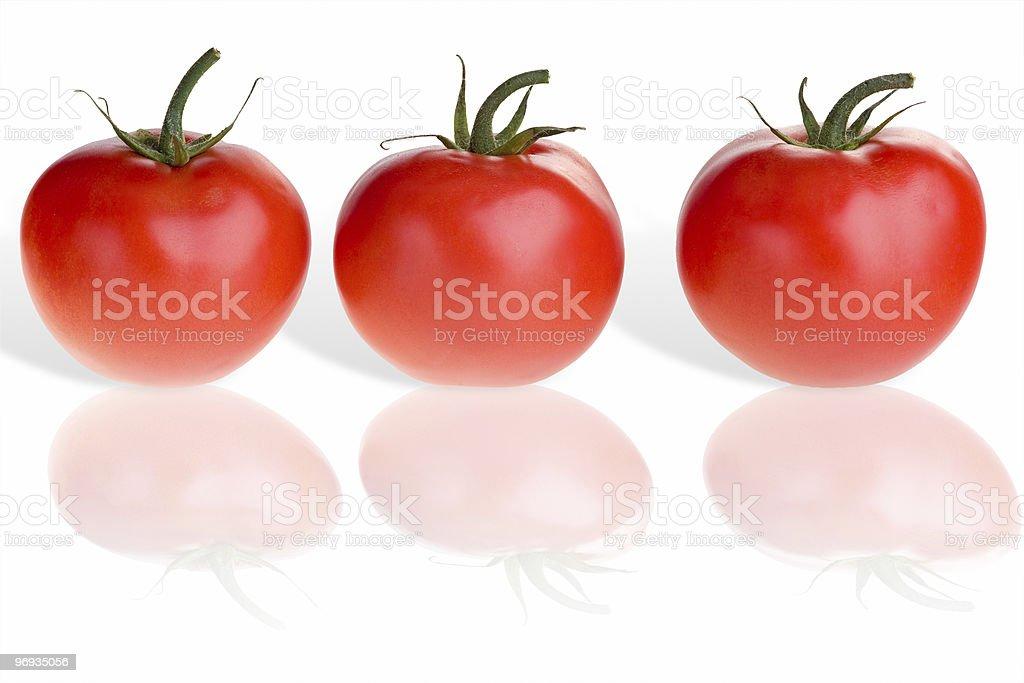 Three tomatoes on white royalty-free stock photo