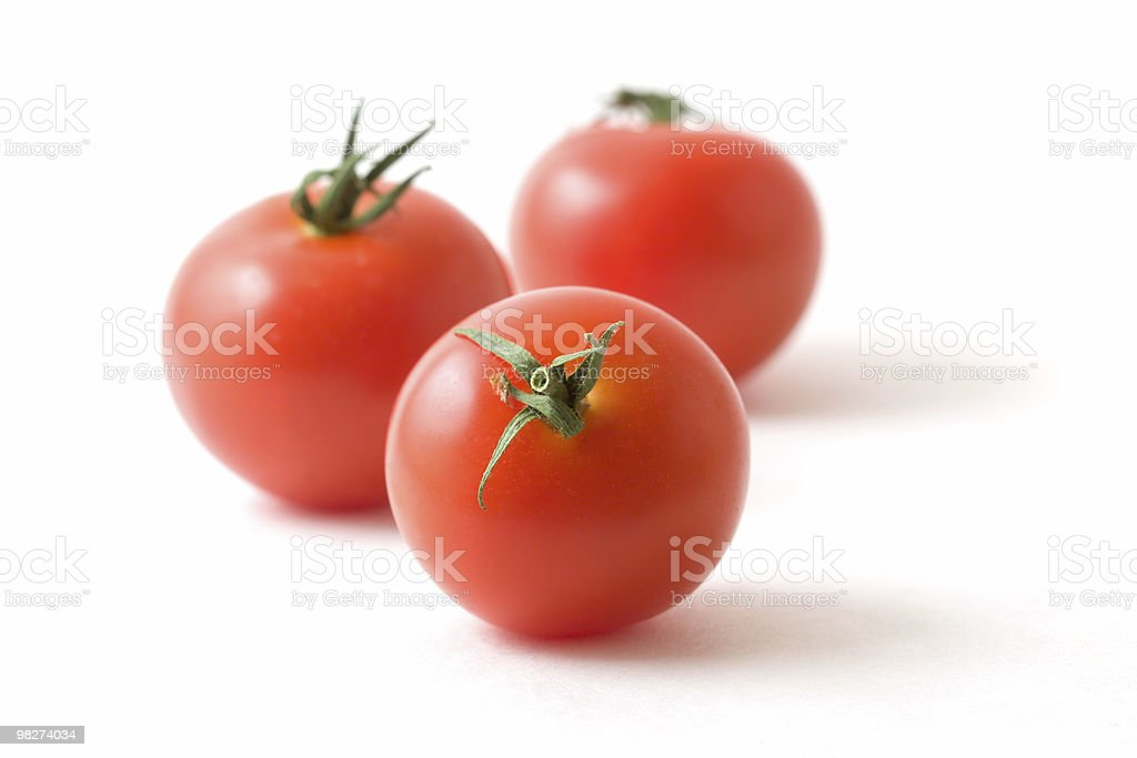 Three Tomatoes on White royalty-free stock photo