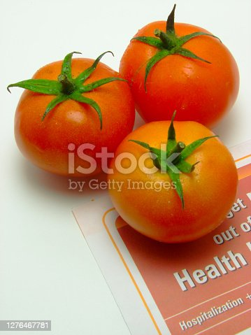 A image of three fresh tomato with a text Health on isolated white background.
