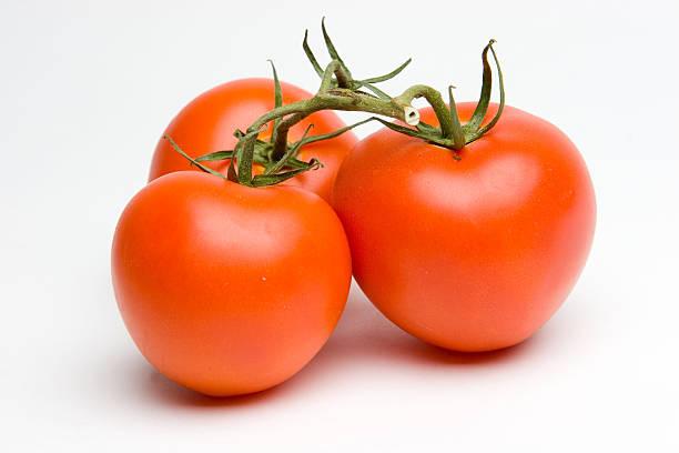 Three Tomatos stock photo