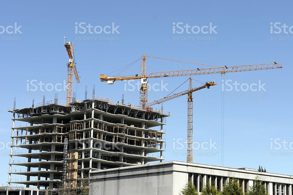 Three tower construction cranes royalty-free stock photo