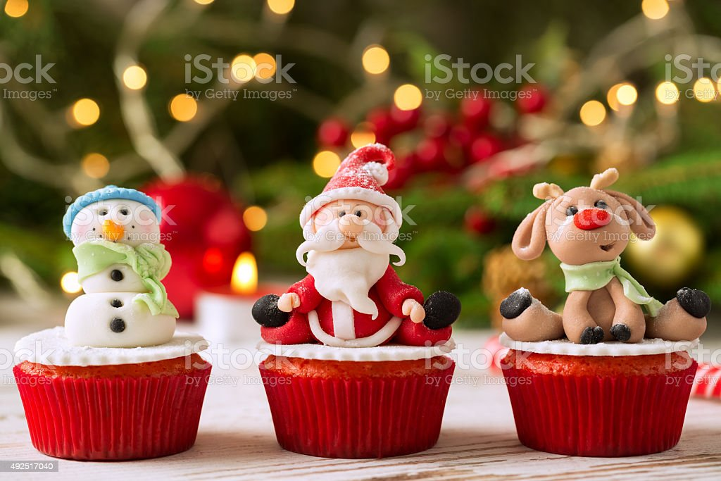 Three traditional decorated christmas cupcakes with festice back stock photo