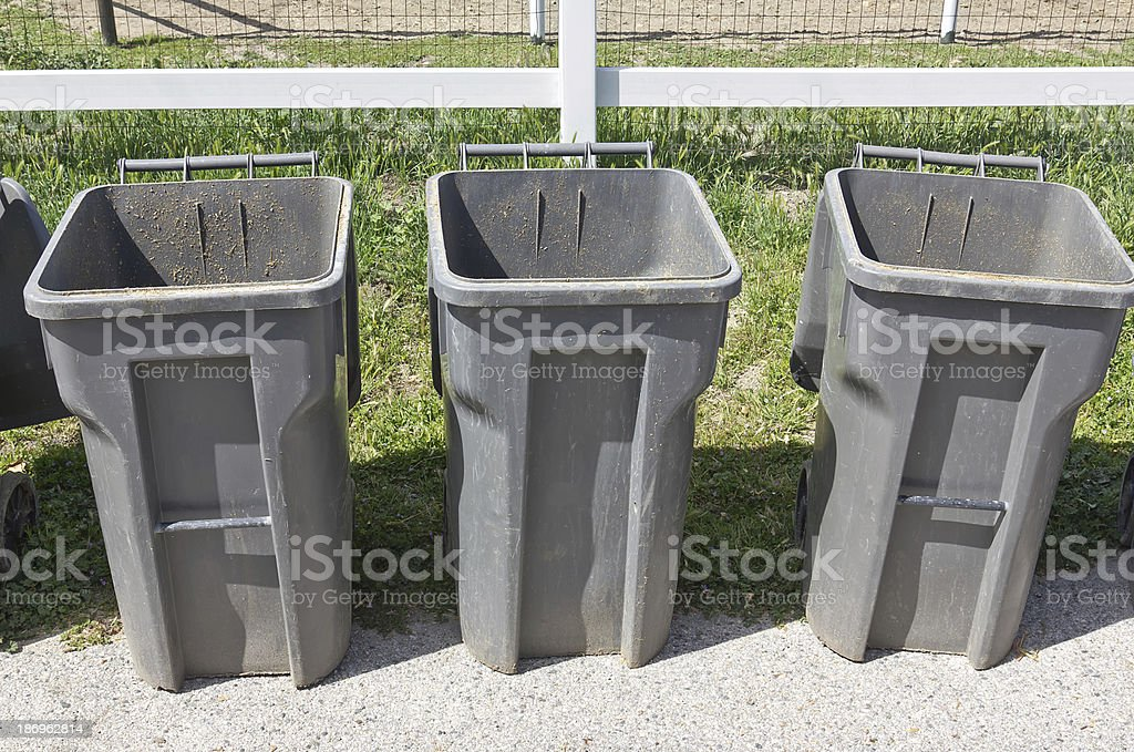 Three Trash Cans royalty-free stock photo