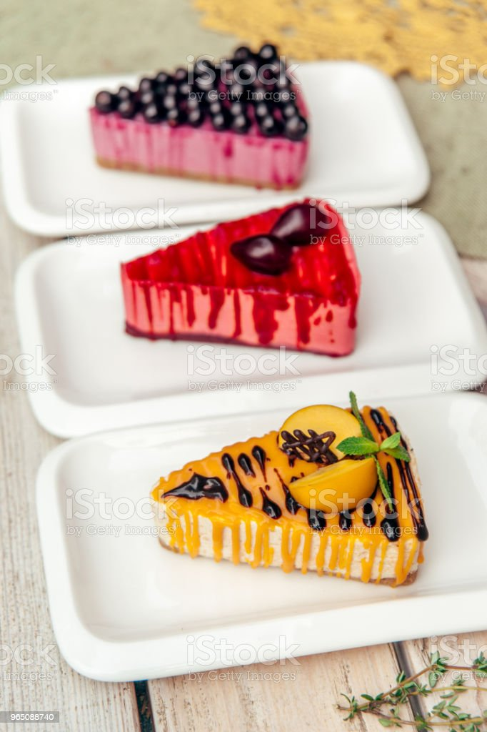 three triangular pieces of cake with apricot plum and currant on wooden rustic table royalty-free stock photo