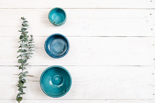 Three turquoise empty ceramic plates. Flat lay