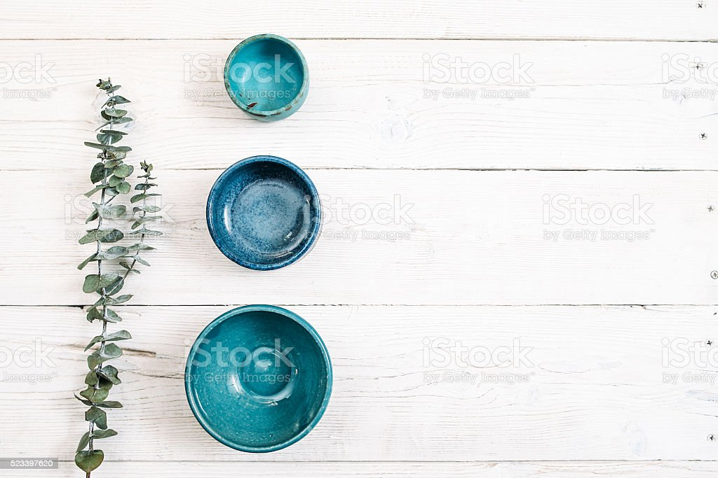Three turquoise empty ceramic plates. Flat lay stock photo