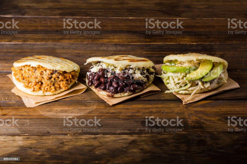 Three types of arepas, Latin American food stock photo
