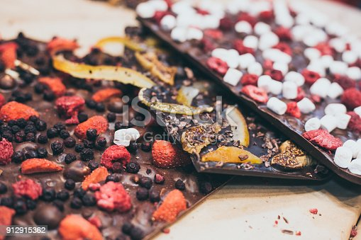 istock three types of craft homemade chocolate with fruits and berries with selective focus 912915362