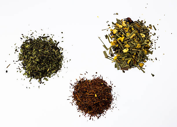 three types of tea - green tea, rooibos tea and ginger tea - tea leaf stock photos and pictures