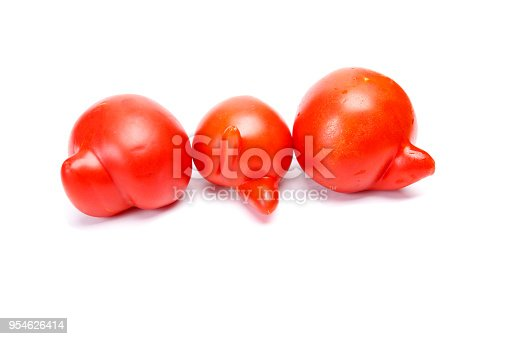 Three ugly tomatoes isolated on white background