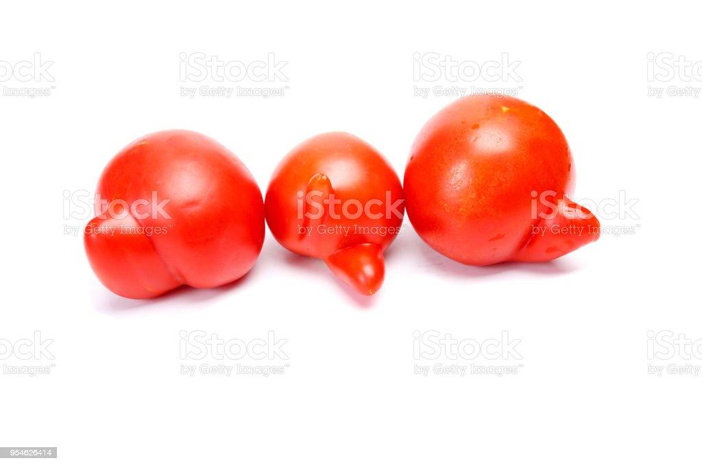 Three ugly tomatoes stock photo