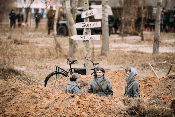 Three Unidentified Women Reenactors Dressed As German Wehrmacht stock photo
