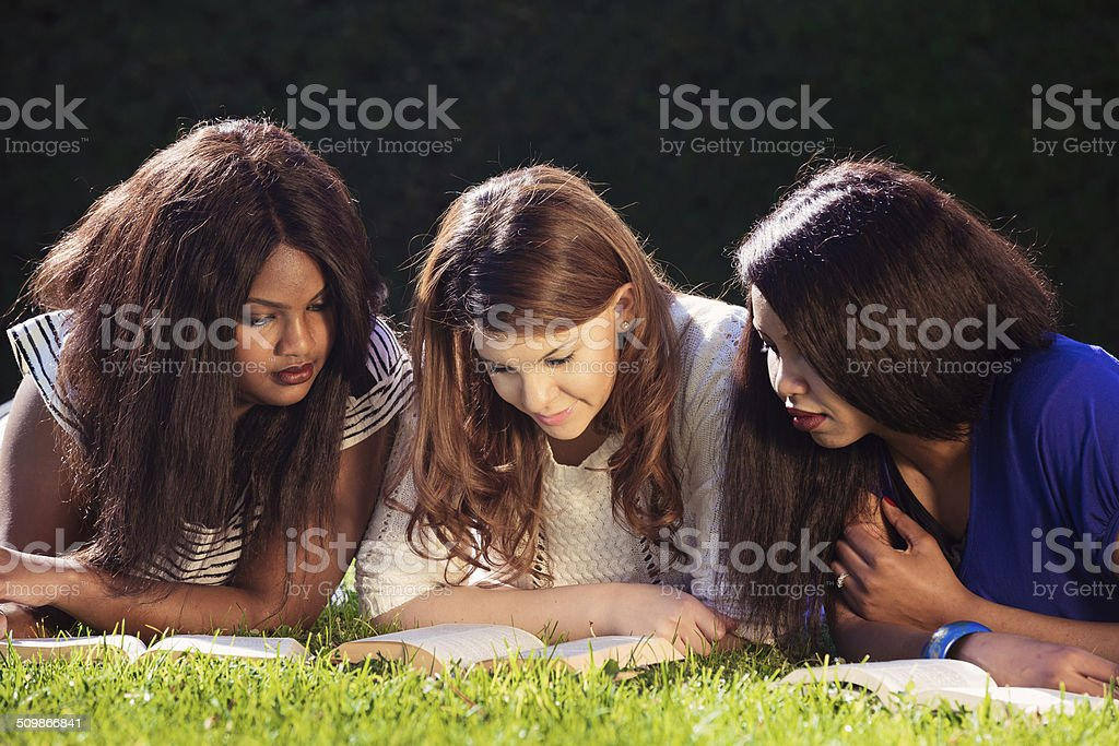 Three University Friends Studying stock photo