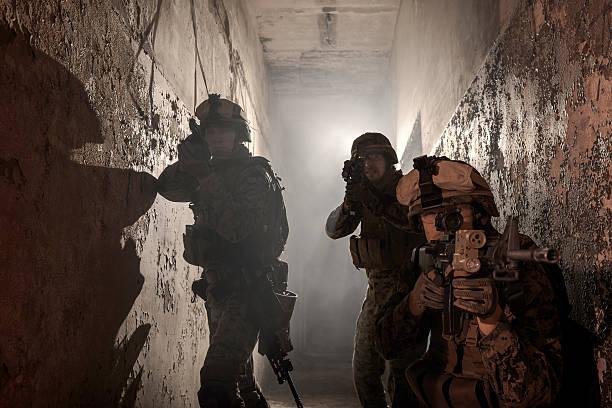 Three U.S. Marines involved in the raid. stock photo